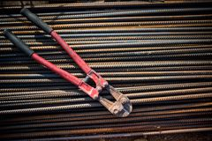 Reinforced steel bars and bolt cutter on building construction site Stock Photo
