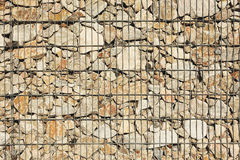 Reinforced stone wall. Steel reinforced stone wall closeup stock photo