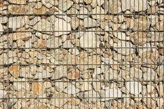 Reinforced stone wall. Steel reinforced stone wall closeup Stock Photo