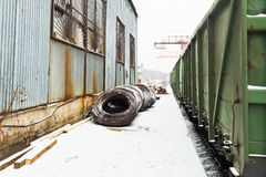 Reinforcement rolls near warehouse on railroad Royalty Free Stock Photography