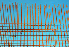 Reinforcement steel bars against blue sky background at construc Royalty Free Stock Photos