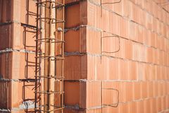 Reinforcement steel bars on pillars, walls and layers of bricks Royalty Free Stock Photos