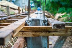 Reinforcement steel in the concrete posts for making the fence. At the construction site royalty free stock photos