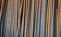 Reinforcing bar, or rebar, is a common steel bar that is hot rolled and is used widely in the construction industry, especially fo. R concrete. Steel Rebar royalty free stock image