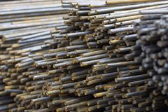 Reinforcing bars in the packs are stored in the metal products warehouse Stock Photos