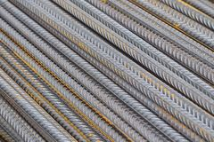 Reinforcing bars with a periodic profile in the packs are stored in the metal products warehouse stock images