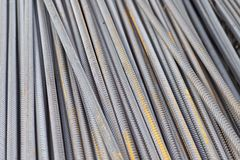Reinforcing bars with a periodic profile in the packs are stored in the metal products warehouse stock photo