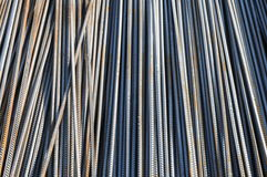 The reinforcing steel bars. With screw threads in bundles background Stock Photos