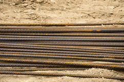 Reinforcing steel bars for building armature on sand Royalty Free Stock Photo