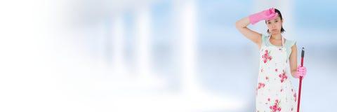 Reinigingsmachine met zwabber met heldere achtergrond wordt vermoeid die royalty-vrije stock afbeelding