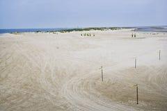 Reinigung-Besatzungen auf dem Strand, Golf-Küste lizenzfreie stockfotos