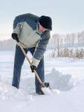 Reinigung des Schnees Stockfotos