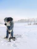 Reinigung des Schnees Stockbilder