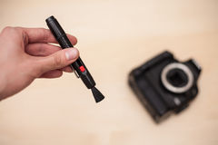 Reinigungs-Digitalkamera mit Pinsel Lizenzfreie Stockfotografie