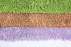 Reinigungsfüße Fußmatte oder Teppich für sauberes Ihre Füße Stockbilder