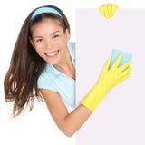 Reinigungsfrau, die Zeichen zeigt stockbild