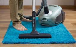 Reinigungsteppich mit Reiniger lizenzfreie stockfotografie
