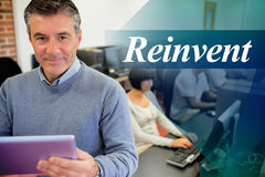 Reinvent against teacher holding a tablet pc Stock Image