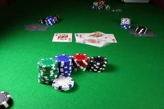 Reis do quadrilátero - a ação disparou em uma tabela do póquer Fotos de Stock Royalty Free