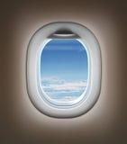Reis door vliegtuigconcept. Vliegtuig binnenlands of straalvenster Royalty-vrije Stock Afbeelding