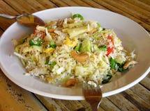 Reis mit Acajoubaum und Ananas Stockbild