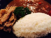 Reis mit Curry Stockfotos