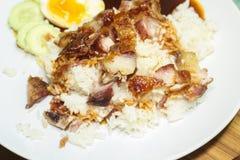 Reis mit gebratenem Schweinefleisch Stockbilder