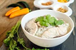 Reis-Suppe mit Seefisch Stockfoto