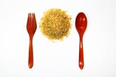 Reis und Löffel Stockfotos
