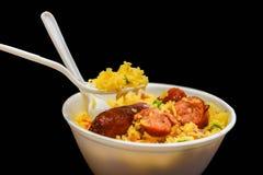 Reis- und Wurstschüssel Stockbild