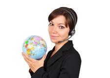 Reisebüro, das auf Kopfhörer spricht stockfoto