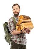 Reisender mit Rucksack und Klotz Stockbild