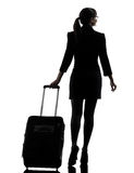Reisendes Gehen der Geschäftsfrau der hinteren Ansicht   Schattenbild stockfoto