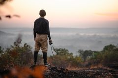Reisephotograph, der Sonnenaufgang betrachtet Stockfoto