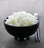 Reisschüssel mit Ess-Stäbchen Stockbilder