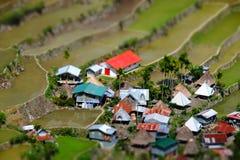 Reisterrassen und Dorfhäuser Banaue, Philippinen Neigungsverschiebung Lizenzfreies Stockfoto