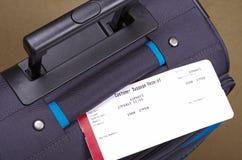 Reiszak en bagagelabel Stock Foto's