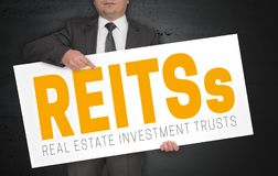 Reit poster is held by businessman.  Royalty Free Stock Photos
