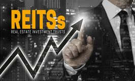 Reit`s concept is shown by businessman.  Stock Photo