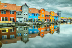 Reitdiephaven street with traditional colorful houses on water, Groningen, Netherlands. Beautiful colorful buildings on water at haven, Groningen, Netherlands stock photos