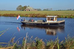 Reitdiepveer z pasażerami, żegluje nad Reitdiep w Groningen Obraz Royalty Free