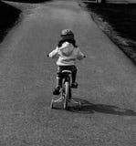Reiten eines Fahrrades Stockbild