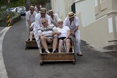 Reitenschlitten der Leute in Madeira lizenzfreie stockfotografie