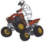 Reiter auf einem roten ATV Stockfoto