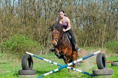 Reiter - Pferden-Springen Stockbild