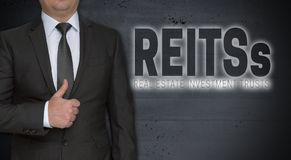 Reits concept and businessman with thumbs up.  Royalty Free Stock Photography