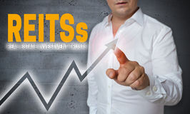 REITs touchscreen is operated by man.  Stock Photography