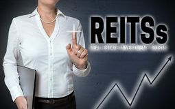 Reits touchscreen is shown by businesswoman.  Stock Image