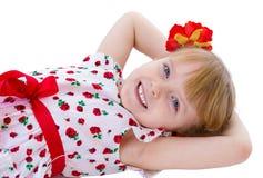 Reizend blonder Blick des kleinen Mädchens. Lizenzfreie Stockfotografie