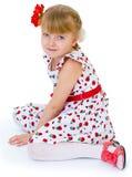 Reizend blonder Blick des kleinen Mädchens. Stockfoto
